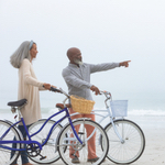 couple riding on a bicycle.